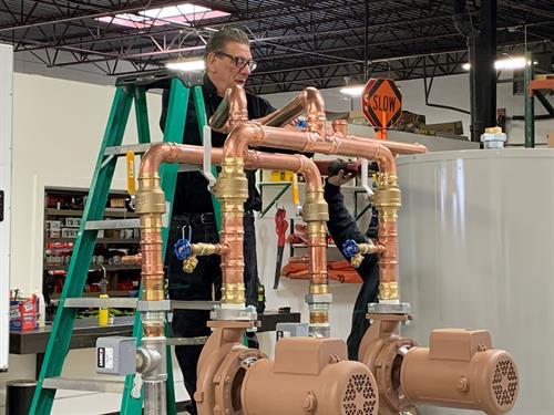 Joe preparing a commercial boiler for installation.