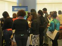 Students learning about careers and businesses at the 2013 Business Expo