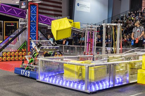 Paseo HS robot throwing a cube at FIRST Robotics Competition 2018