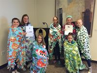 6th Grade Volunteers.  These youngsters did 10 blankets for ShareHugs!