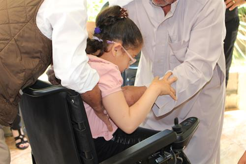 Girl with Cerebral Palsy received Motorized Wheelchair
