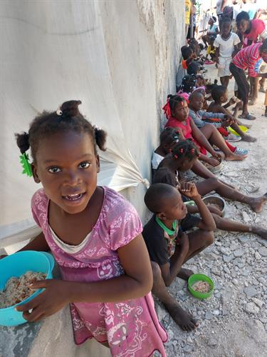 Girl at one of our 8 feeding locations