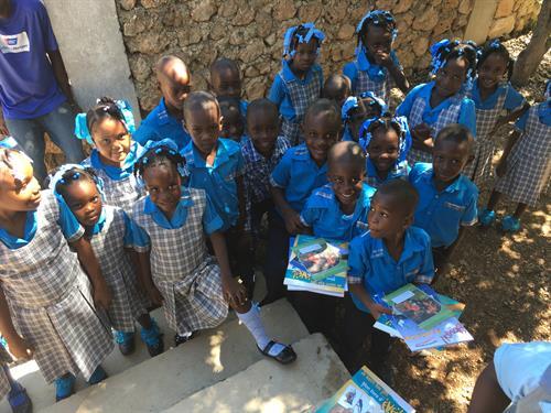 Children recieving their School books