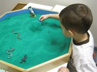 Sand tray therapy is a helpful way for children who have been sexually abused to recreate their world and express what they feel and are afraid of.