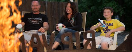 Gallery Image Family_sitting_around_campfire_at_Rip_Van_WInkle_Campgrounds.jpg