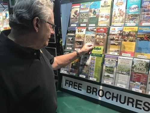 Looking for brochures at the Anderson's Booth