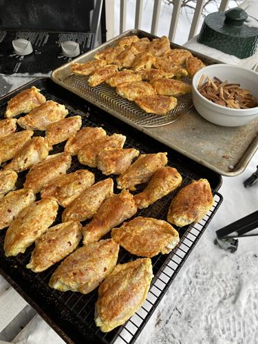 Dry brined wings in TJ's Florida Sweet N' Fire flavoring - smoked on the grill!