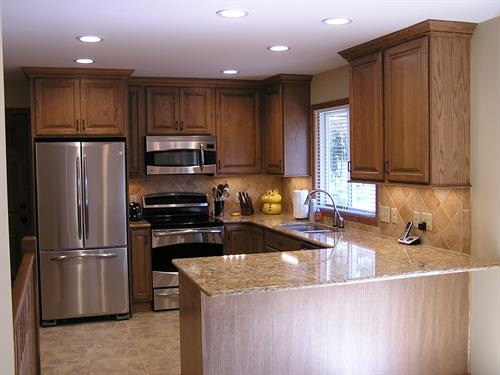Kitchen with Oak Cabinetry and Cambria Countertops