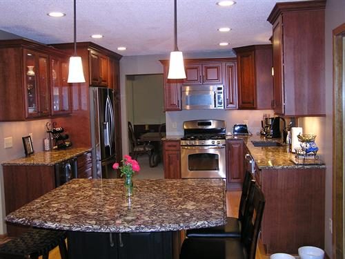 Kitchen with Cherry Cabinets and Cambria Countertops