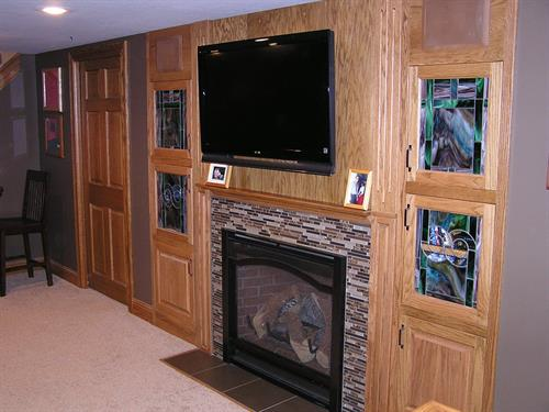 Custom fireplace with oak and stained glass built-ins