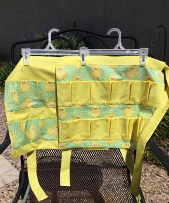 Child's egg apron, yellow chicks, 25. 10 pockets. Can resize smaller with fewer pockets.