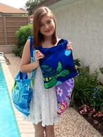 Beach towel bags, 20. One piece: attached bag, shoulder strap, front pocket with velcro for small items.
