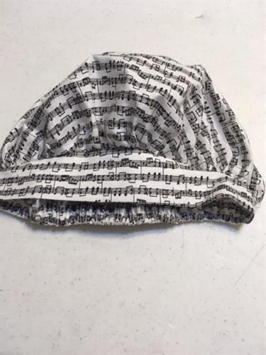 Scrub caps, 18, 2/35. Ladies design shown. Men's design available. All many fabrics.