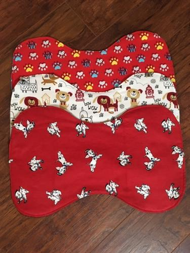 "Doggie placemats, medium: 17.Triple layered, washable, many designs 17x10.5"" same as above"