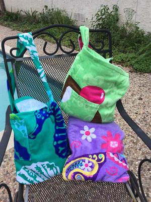 Beach towel bags, seasonal designs vary. Specify broad catagories: fish, camo, pink or purple....