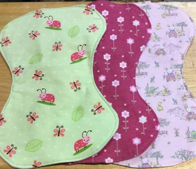 Burp cloths: 6, multiples 5. Sample girls' designs shown. Triple layered for absorbency. Generic designs too.