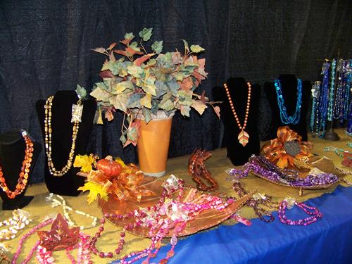 Jewelry displayed on large leaf-shaped trays