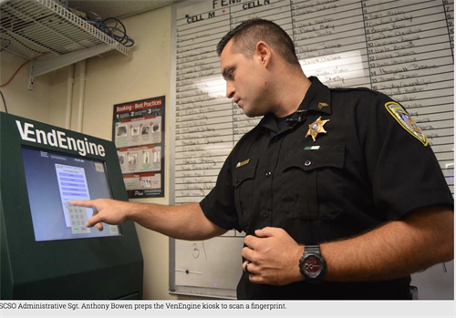 Corrections Officer utilizing technology