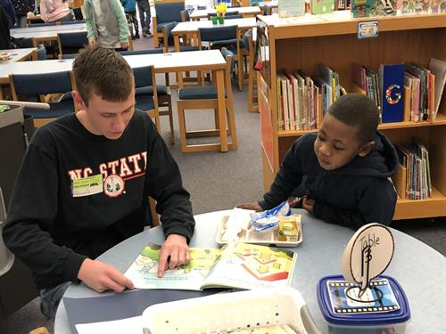 WakeEd's Partners Read program pairs first graders with volunteers to practice reading on Friday mornings.