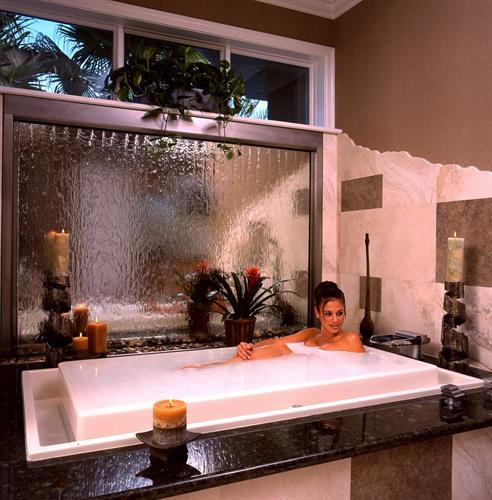 Bring moving water and sound indoors with glass and stone water-wall fountains.
