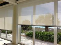 Textilene 90% solar screen over sliding glass doors for UV protection
