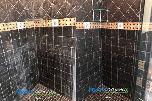Restored Black Limestone shower.  The white is etching damage from acidic cleaner.
