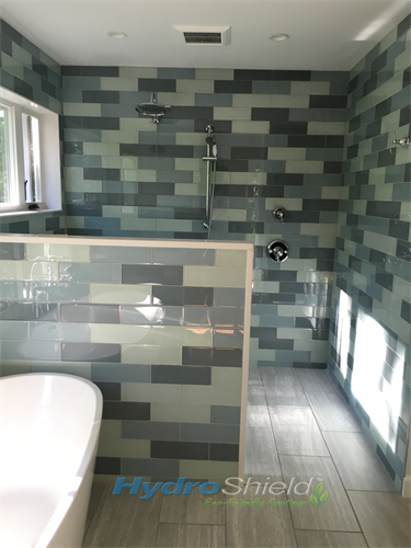 Glass shower tiles are especially difficult to keep looking new.  Mineral deposits and soap scum a very visible