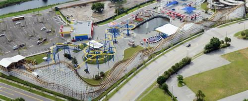 White Lightning located at Fun Spot in Orlando, FL. Steel structure, wood track coaster built by Great Coasters International (GCI).