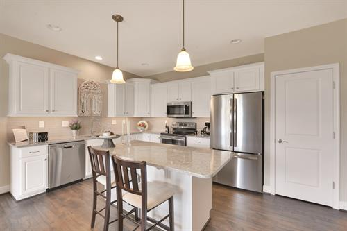 Gorgeous White Kitchen with granite island and stainless steel appliances