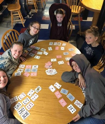 Teens enjoying a card game