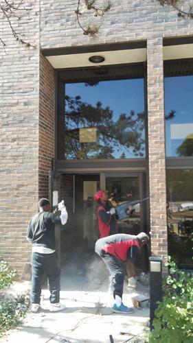 Removing Exterior Steel Door Frame Sold at Glenview Village Hall Pre-demolition sale