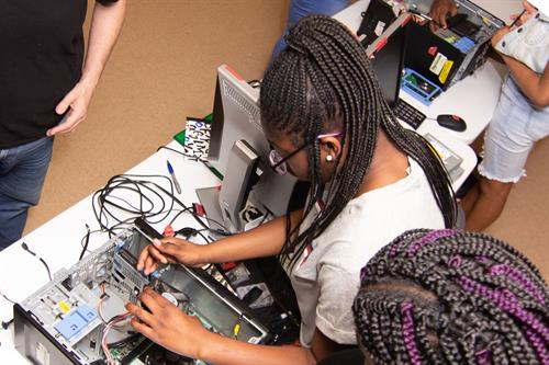Innovators learning how to troubleshoot repairs to a desktop computer