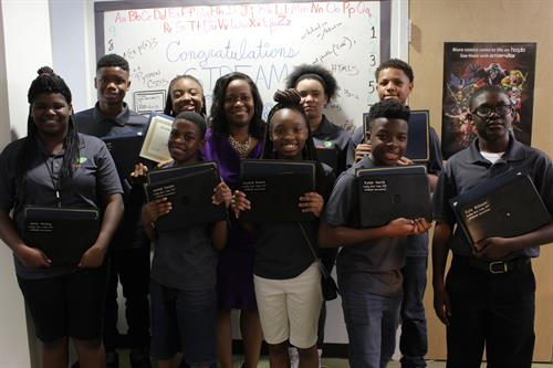 Our first year of Innovators receiving an HP STREAM laptop for completing the STREAM Coding Boot Camp in 2017