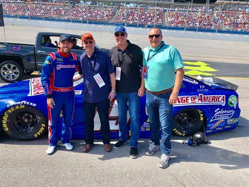 Talladega driver Ross Chastain, Harlan Hamlin, Blake Svoboda, Mike Francis. Check out the bottom right of the car!