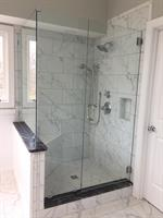 "Porcelain tile ""marble look"" shower with Thunder Black honed granite curbs"
