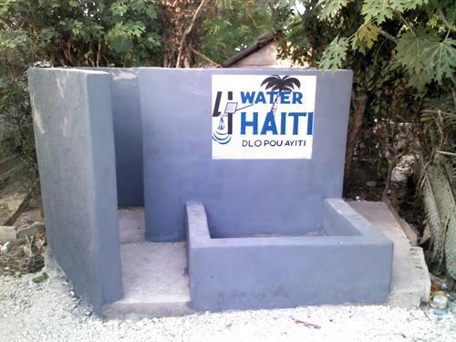A picture of a bathing area. A pump is near by and this construction gives privacy for taking a bath. We have constructed 4 of these very appreciated projects.
