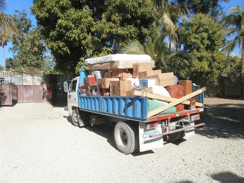 A truck load of supplies headed for an orphanage which had been brought down from America. Beds, desks, shoes, clothes, benches, eating plates, glasses, silverware and on and on. Nearly an orphanage every so many blocks (an exaggeration), but there are hundreds and hundreds of babies and young kids in homes from 20 to 80.