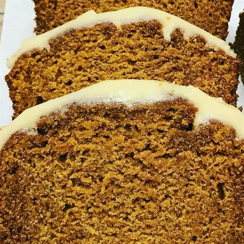 fresh-baked pumpkin bread with brown butter frosting