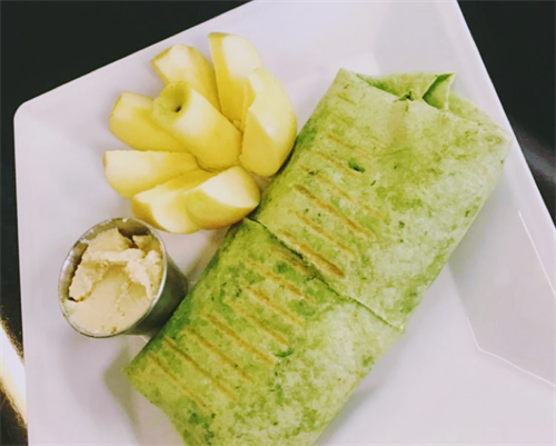 a veggie wrap with an apple
