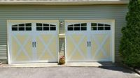 Clopay Coachman Model CD21 With Arch 3 glass and a Custom paint job by Hunter Door