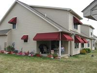 Burgundy window awnings - Sunbrella fabric