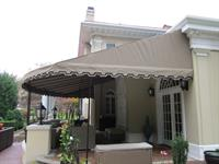 Stationary Canopy following the round contour of the patio