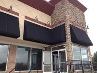 Funck's Restaurant - storefront awnings - black sunbrella fabric