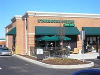 Green Sunbrella shed style awnings installed at the Lititz Starbucks