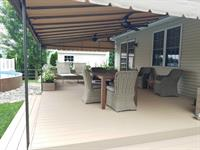 Deck canopy with two ceiling fans and powder coated framing