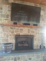 It took five members to get this TV over the fireplace.  90in TV.
