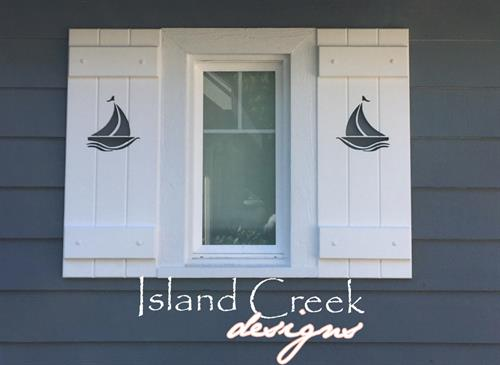 Custom PVC Board & Batten Style Shutters with Nautical Sailboat Cutout