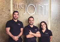 Our Team at The Joint Carrollwood - (left to right) Noah Frey (Mngr), Dr. Victor Hugo Gomez (Chiropractor), Corina Gonzalez (Wellness Coordinator)