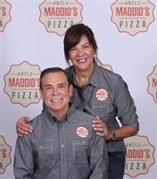 owners of Uncle Maddios Ada & Mike Mateo