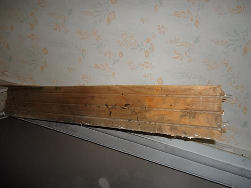 Fire soot travels everywhere air goes, even behind baseboards